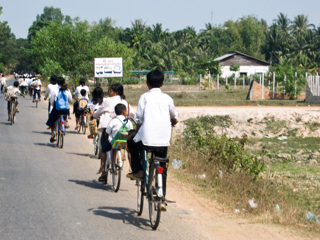 Banner_students_biking_home_-_asia_